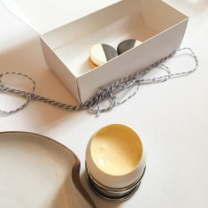 Savory cookies made with apple and cheddar in stylish B/W and a little egg filled with sturgeon caviar, sabayon and chives.