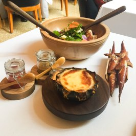 A beautifully melted Cato Corner cheese fondue sitting in a squash.